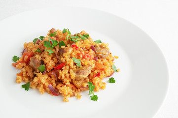 wheat with mutton pieces, cooked with onion, pepper, and tomato