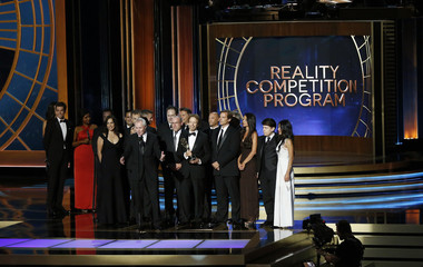 """Executive producer Bertram van Munster accepts the award for Outstanding Reality-Competition Program for """"The Amazing Race"""" onstage during the 66th Primetime Emmy Awards in Los Angeles"""