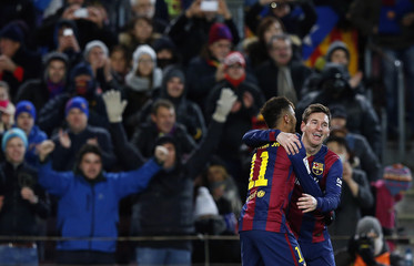 Barcelona's Messi celebrates his goal against Villarreal with team mate Neymar during their Spanish first division match in Barcelona