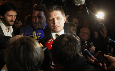 Slovakia's social democratic political party leader Smer Robert Fico speaks to the media as he arrives at the party's headquarters to observe the exit polls after the country's early general election in Bratislava