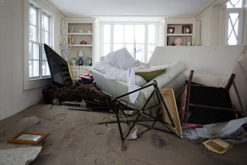 Furniture and sand pushed up against a wall by the storm surge of superstorm Sandy stand piled up against shelves with items still piled onto them in the town of Mantoloking