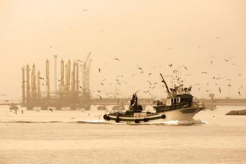fishing boat arriving at Coruna port , Spain