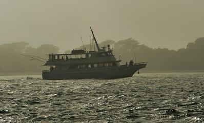 Seminole Tribe members, aboard a charter boat, depart Egmont Key State Park