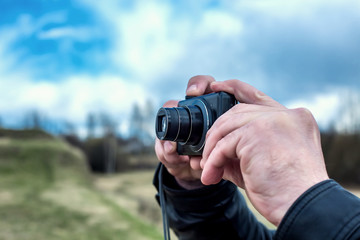 Photographer. Close up portrait of man holding vintage camera. Man photographed something in nature
