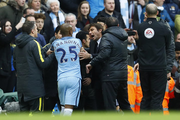 Manchester City's Fernandinho clashes with Chelsea manager Antonio Conte after being sent off