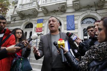 Dancu, lawyer of Radu Dogaru, the suspected Romanian ringleader, speaks to the media at a court in Bucharest