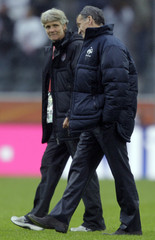Coaches of the U.S. Sundhage and Bini react after their Women's World Cup semi-final soccer match in Moenchengladbach