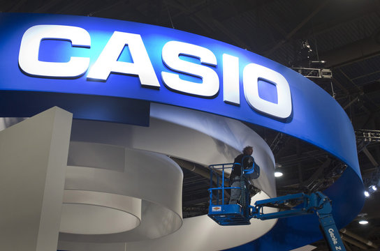 Worker checks on lights at a Casio booth during preparations for the 2014 Consumer Electronics Show (CES) at the Las Vegas Convention Center in Las Vegass