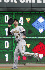 Pirates' Lambo makes the play on a fly ball off the bat of Reds' Rodriguez during the eighth inning of their MLB National League baseball game in Cincinnati