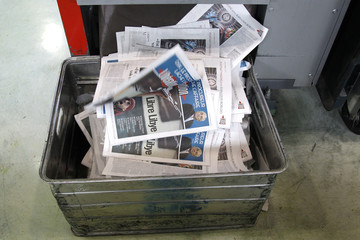 View of front page of French daily morning newspaper Liberation at their printing press in La Courneuve near Paris