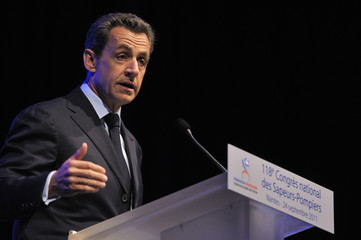 France's President Sarkozy delivers a speech as he attends a firemen congress in Nantes