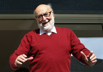 Belgian physicist Francois Englert appears at the balcony of his house in Brussels, after he and Britain's Peter Higgs won the Nobel prize for physics