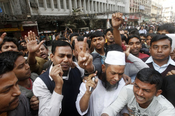 Investors demonstrate as they block roads in front of the Dhaka stock exchange in Dhaka