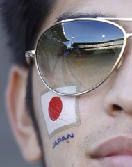 A Japan fan waits for the start of their 2010 World Cup Group E soccer match againt Cameroon at Free State stadium in Bloemfontein