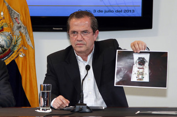 Ecuador's Foreign Minister Patino shows a picture of a hidden spy microphone uncovered at the office of Alban, Ecuadorean ambassador to the United Kingdom, during a news conference in Quito