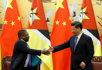 Chinese President Xi Jinping and Mozambican President Filipe Nyusi shake hands at a signing ceremony at the Great Hall of the People in Beijing