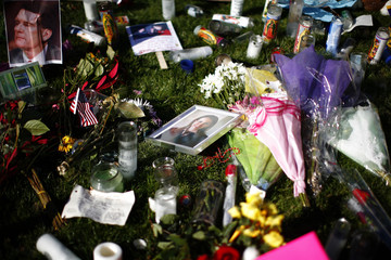 A framed photograph of U.S. Representative Gabrielle Giffords is seen placed at a makeshift memorial set up for the victims of the January 8 shooting outside the University Medical Center in Tucson, Arizona
