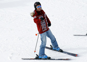 Russian Prime Minister Dmitry Medvedev skis at the Rosa Khutor Alpine Center during the 2014 Sochi Winter Olympics