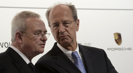 Martin Winterkorn, CEO of German carmaker Volkswagen, talks with his CFO Hans Dieter Poetsch during a news conference in Wolfsburg