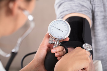 Doctor Measures Her Blood Pressure
