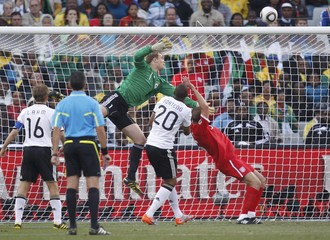 England's Upson scores a goal during the 2010 World Cup second round soccer match against Germany at Free State stadium in Bloemfontein