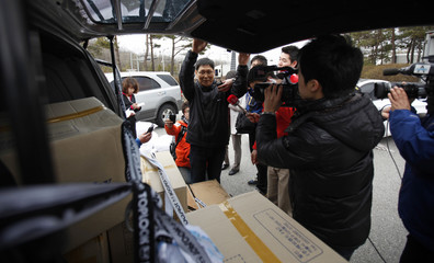 Reporters question a South Korean employee as he returns from the Kaesong industrial complex, in Paju