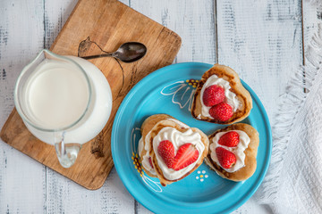 pancake in the shape of a heart with strawberries