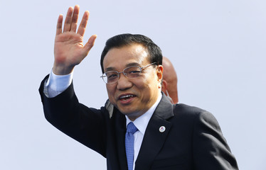 China's Premier Li Keqiang arrives for the Asia-Europe Meeting in Milan