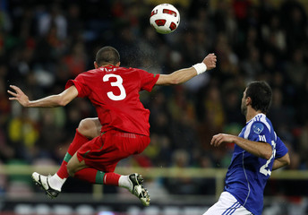 Portugal's Pepe fights for the ball with Finland's Alexei Eremenko in Aveiro city stadium