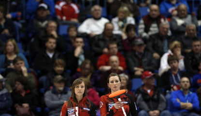 Canada's Homan and Miskew look on during draw against Sweden at World Women's Curling Championships in Saint John