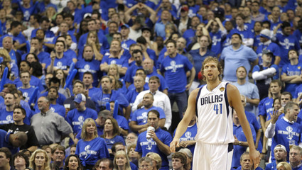 Dallas Mavericks Dirk Nowitzki looks up with Mavericks fans standing in the background during Game 4 of the NBA Finals basketball series against the Miami Heat in Dallas