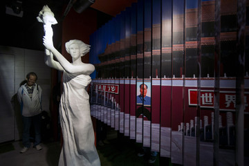 A visitor looks at a statue of the Goddess of Democracy at Hong Kong's museum dedicated to the Tiananmen Square pro-democracy protests, in Tsim Sha Tsui