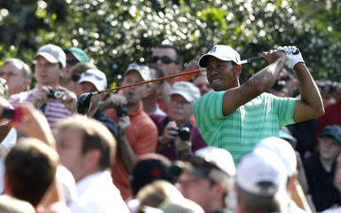 Tiger Woods of the U.S. hits his tee shot on the 15th hole during a practice round for the 2012 Masters Golf Tournament at the Augusta National Golf Club in Augusta