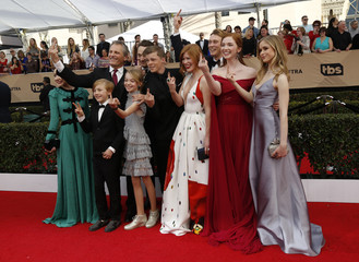 """The cast of """"Captain Fantastic"""" make gestures as they arrive at the 23rd Screen Actors Guild Awards in Los Angeles"""