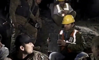 Pakistani army and emergency services look at the black box during the rescue operation at a remote crash site where a plane carrying 47 people crashed into a northern Pakistan mountain, in this still frame taken from video
