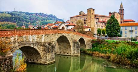 impressive medieval Bormida monastery and castle in regione Asti in Piemonte, Italy Fototapete