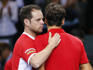Switzerland team captain Luethi talks to Federer after Federer won his Davis Cup quarter-final tennis match against Kukushkin of Kazakhstan in Geneva