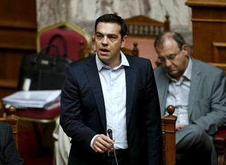 Greek PM Tsipras speaks during a parliamentary session in Athens
