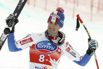 Theaux of France celebrates his third place following men's Alpine Skiing World Cup Downhill race in Rosa Khutor