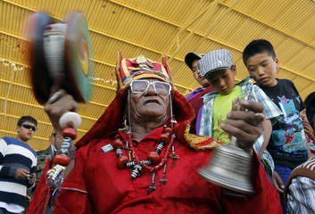 Man wearing traditional attire performs a song in Leh