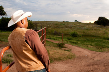 Rear view of an African American cowboy.