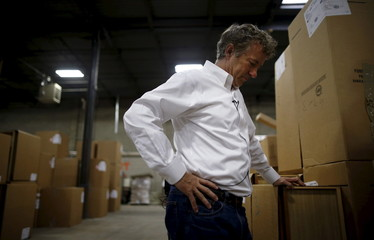 U.S. Republican presidential candidate Senator Rand Paul of Kentucky listens to his introduction during a campaign stop at Royal Kitchen and Bathroom Cabinets in Niles, Illinois