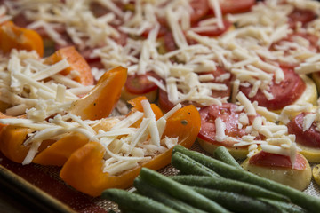Vegetables ingredients oven bake preparation, metal tray, tomato, cheese, pepper, beans, window light