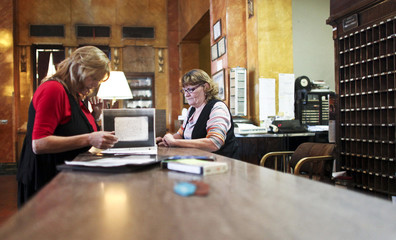 Hotel manager Robin Brekhus and supervisor Brenda Maly search through the Gadsden Hotel's collection of haunted experiences guests have written about while staying at the hotel in Douglas