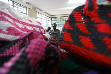 Women weave polythene baskets at the community-based organisation Mirror of Hope in Nairobi