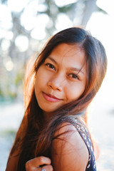 Portrait of a young woman with positive attitude smiling
