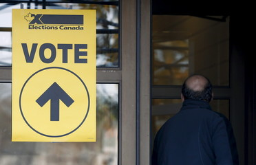 A voter enters a polling station in Quebec City