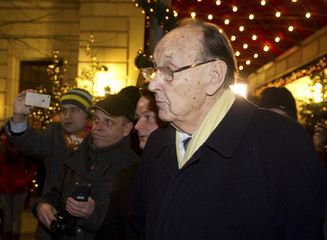 Former German Foreign Minister Hans-Dietrich Genscher of the liberal Free Democratic Party (FDP) leaves a hotel in Berlin