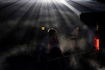 A glassmaker works next to a furnace at Cespedes factory in Olocuilta