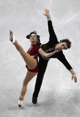 Gillespie and Dematte of Italy perform during their pairs free skating programme at the European Figure Skating Championships in Sheffield